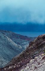 blue dusk rainclouds descend on Death Valley (carlfieler) Tags: canona1 canonfd fd85mm18 analog analogfilm 35mm 35mmfilm 35mmcolorfilm colorfilm shootfilm deathvalley califnoria california desert landscape rain clouds weather
