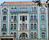 Art Nouveau era apartment building, pale blue and white - Lisbon (Monceau) Tags: blue façade building apartmentbuilding windows round rounded graceful ironwork flower tiles ornamentation ceramic lisbon artnouveau style design