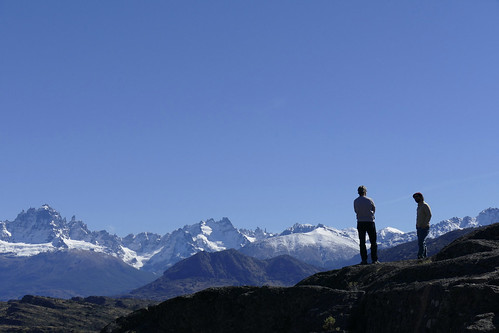 chile-patagonia-aysen-cerro-castillo-two-people-in-silhouette-with-mountains-behind
