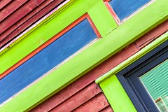 How Many Colours? (Karen_Chappell) Tags: downtown city urban house colours jellybeanrow stjohns rowhouse green purple blue red wood wooden paint painted colourful multicoloured clapboard lines geometry geometric abstract newfoundland nfld colour color tilt angle rectangle canada atlanticcanada avalonpeninsula