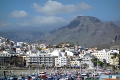 Port of Los Cristianos (Picturos404) Tags: europe spain canary canarian islands tenerife loscristianos lasamericas port ships boats sailboats mountains volcano teide sky skyline clouds building architecture atlantic ocean seaside shore embankment