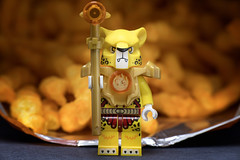 Guardian of the Cheetos. (Eugene Lagana) Tags: once upon a time macro monday mondays cheetos fritolay frito lay cheese lego small mini tiny toy toys yellow