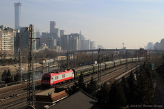 I_B_IMG_8367 (florian_grupp) Tags: asia china locomotive train railway railroad passenger diesel electric beijing station citywall beijingmainstation chaoyang peking cnr chinanationalrailway traffic bluesky