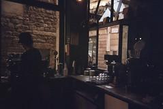 Satan's coffee (Nuria Ocaña) Tags: 35mm film filmisnotdead travel trip atmosphere obscure darkness satans satanscoffee coffee born barcelona dark gloomy cafe city urban winter barista machine kodak