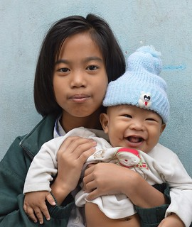 pretty girl with happy baby