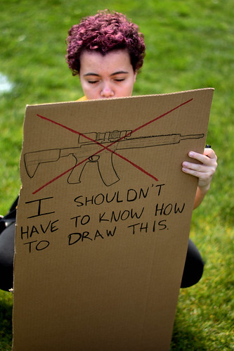 From flickr.com: sign reads: I shouldn't have to know how to draw this [picture of an AR-15 semi-automatic] {MID-275568}