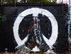Peace for Manchester (Steve Taylor (Photography)) Tags: cnd leather gloves holding clamping sinew symbol hands fanakapan peaceformanchester bomb terrorism graffiti tribute memorial mural streetart railing black orange white sad uk gb england greatbritain unitedkingdom london staryard drips runs can paint