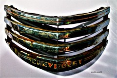 Chevy Grill (SCOTTS WORLD) Tags: adventure america automobile automotive reflection rusty crusty silver chevrolet grill display exploring exhibit renaissancecenter detroit digital decay downtown detail detroitderek 313 urban usa unitedstates historic light shadow shiny car panasonic