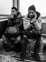 Snow day travels (dharder9475) Tags: 2018 androidphotography bw blackandwhite candid chicagotransitauthority cta friends onthephone pensive privpublic sitting streetphotography thinking