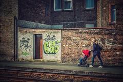 Mutter mit Kind... (hobbit68) Tags: mother children child kinderwagen graffiti frankfurt fechenheim windows fenster wall mauer woman frau schienen strasenbahn streetfoto door tür
