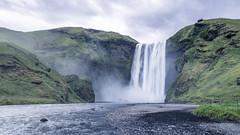 Skógafoss (dawvon) Tags: iceland skógafoss landscape waterfall travel nature people skógar nordic tourist suðurland europe skógáriver cloudy lýðveldiðísland republicoficeland skogar southernregion ísland
