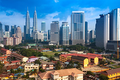 Kuala Lumpur Cityscape (baddoguy) Tags: architecture blue building exterior built structure business capital cities city cityscape cloud sky color image community copy space curve downtown district dramatic economy environment environmental conservation famous place finance front or back yard government green horizontal international landmark kuala lumpur landscape malaysia modern national no people outdoors petronas towers photography politics road skyscraper social issues southeast asia street sunrise dawn sunset tall high town transportation twilight urban skyline