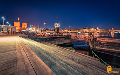 Aker Brygge at evening. (pramodphotography7) Tags: akerbrygge oslo norway stairs line clock rådhuset akershusfestning fjord sea light night blue streetlight
