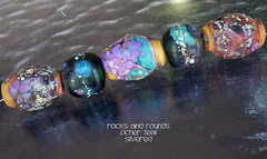 Rocks and Rounds Ocher Teal Silvered (Laura Blanck Openstudio) Tags: openstudio openstudiobeads set glass handmade murano lampwork beads bead big rocks pebbles stones nuggets whimsical funky odd multicolor colorful abstract asymmetric earthy organic speckles frit fine arts art artistic artisan made usa lilac grape lavender violet plum eggplant rounds donuts sterling silver silvered yellow ocher coral orange maize green teal emerald burnt umber peach brown honey caramel suede mustard matte etched opaque frosted glow glowing