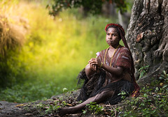 Waiting (wu di 3) Tags: dani woman environment portrait flower purple tree waiting tribe papua asia west indonesia