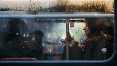 The passenger 143/156 (markfly1) Tags: brighton passenger woman bus travelling alone pressing button red yellow blue green lights bokeh color colours candid street image england uk lines rain raindrops shadows d750 50mm nikkor lens