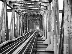 Long Bien bridge, Hanoi (Hammerhead27) Tags: grey mono monochrome bw blackandwhite infinity tourist metal historic old vietnam hanoi crossing river train rail railroad steel bridge longbien