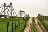 the river (Wöwwesch) Tags: fence bridge waal way sky