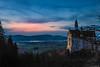 Tourist attraction in the twilight (Ilia Danilov) Tags: germany travel world mountains neuschwanstein schwangau flickr sunset europe nature