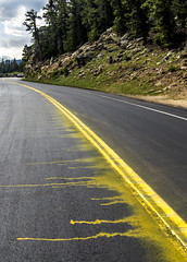 Do not stripe a road in the rain! (photographyguy) Tags: rockymountains echolake rockies road funny rain striping highway statehighway103 mountains rocks oops wetpaint paint yellow colorado waterbasedtrafficpaint