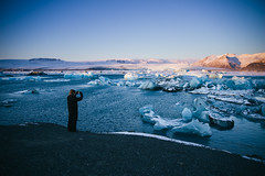 Vatnajökull (BurlapZack) Tags: easternregion iceland is pentaxk1 pentaxhddfa28105mmf3556eddcwr vscofilm pack01 vatnajökull glacier bay water ocean tourist selfie portrait humanscale mountains glaciers icebergs ice snow winter traven travel vacation adventure nature exploration explore explorer sunset evening pink blue shore shoreline edge meta photographer