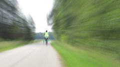 The fastest milkmaid in the east. (John Spooner) Tags: gimp composite fast cyclist whoosh road tree motionblur blur blurred