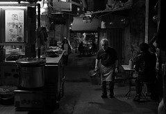"""preparing for another tomorrow"" (hugo poon - one day in my life) Tags: xt20 35mm hongkong gutzlaffstreet central 水記 daipaidong citynight goodevening longnight solitude dark vanishing eating streetlife stall lane alley acros"