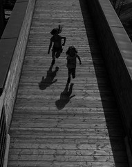 run (Georgie Pauwels) Tags: run shadows children candid unposed sunlight light street streetphotography moment olympus way