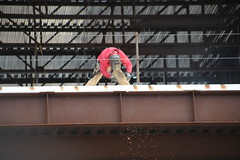 02Apr2018-SanFrancisco-IMG_3212 (aaron_anderer) Tags: sanfrancisco urban downtown city california 2018 mosconeconventioncenter grinding welding workers construction girder crane heights steelworker metalworker hardhat safety