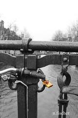 Lock (n.fischer_picture) Tags: key lock bicycle amsterdam water rain colourkey heart love grey black white
