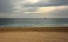 A Ship at Sea (henriksundholm.com) Tags: sea ocean landscape nature horizon ship boat sand beach playa postiguet playadelpostiguet alicante costablanca spain espana hdr waves daylight cloudy sky footprints tracks coast