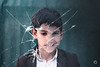 Violence Against Children (Hands of Skill) Tags: face child kid glass shattered broken innocence eos d550 canon violence smile photoshoped concept conceptual