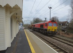 DB Red Shed 66152 heads the 14.42 Whitemoor - Alexandra Palace Ballast working over Roydon Level Crossing at a fine pace. 25 03 2018 (pnb511) Tags: train diesel loco locomotive track station class66 overhead electrics levelcrossing roydon herts hertfordshire