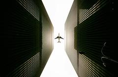 Reflected Symmetry [REDUX] (Dan Haug) Tags: canyon newyorkcity nyc manhattan aircraft skyscraper architecture highkey monochrome blackandwhite reflection linear lines xf1024mmf4rois xt1 fujifilm redux getty gettyimages