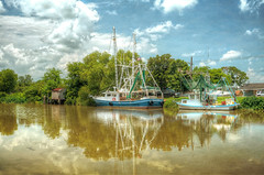 Classie Lady and The Stumpy Marie - Bayou Lafourche Louisiana (John E Adams) Tags: louisiana highway1 bayou water clouds shrimpboats boats trees reflection rural