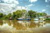 Classie Lady and The Stumpy Marie - Bayou Lafourche Louisiana (John E Adams) Tags: louisiana highway1 bayou water clouds shrimpboats boats trees reflection rural