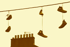 Shoes In Strange Places 3 (Lady Vervaine) Tags: street city uk urban strange sepia shoe scotland weird shoes britain glasgow pair surreal trainers gravity converse pairs hanging suspended hang bizarre weightless gravitydefying shoesinstrangeplaces