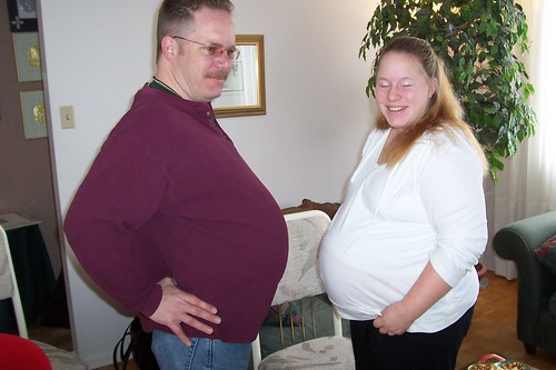 A pot-bellied man and his pregnant niece
