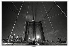 The Couple (Arnold Pouteau's) Tags: nyc newyorkcity bw newyork night manhattan brooklynbridge diamondclassphotographer