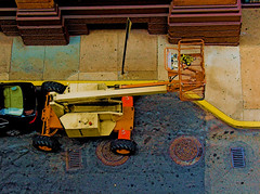 spamoetry... (bruce grant) Tags: orange philadelphia cherrypicker parkinggarage crane pavement alleyway carpark 4thstreet manholes petitruban highangle nogas ritzatthebourse