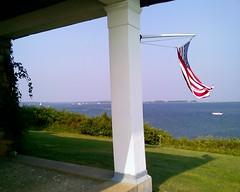 flag over PBN (sita puddin pie) Tags: ocean water bay boat capecod flag lawn porch column narrows pleasantbay pbn greatgrans southorleansma