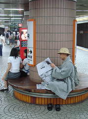 Metro monk (Photocapy) Tags: underground subway newspaper uniform metro sandals monk buddhism korea seoul schoolgirl