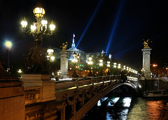 paris, city of lights (*bratan*) Tags: bridge blue paris france monument colors seine night river lights bravo russia streetlamps quality capital statues rays grandpalais tsar alexanderiii abigfave photofans outstandingshot