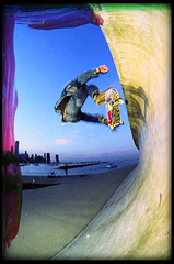 Patrick FS Ollie@Seawall (candersonclick) Tags: shadow chicago skyline skateboarding patrick seawall lakemichigan fisheye ollie artsyfartsy nikonf4 melcher slaveflashes 16mmfisheye