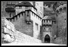 Kreuzenstein Castle (fcphoto) Tags: vienna wien city light shadow blackandwhite bw white black building sterreich tower castle art history face wall architecture clouds photoshop dark landscape austria gate war europe minolta bright near photoshopped fineart attack perspective swedish historic stadt knight drawbridge defense destroyed rebuild 100club rebuilt correction kreuzenstein 1645 50club fcphoto abigfave burgkreuzenstein kreuzensteincastle