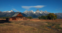 Mormon Row Barn and Tetons in Mid Morning Light (Fort Photo) Tags: travel vacation mountains nature landscape nikon d70 nps 2006 historic wyoming tetons nationalparks grandtetonnationalpark mormonrow specnature nikonstunninggallery abigfave bestnaturetnc06