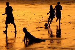 pemain (Farl) Tags: travel sunset bali game beach colors silhouette kids ball indonesia gold coast football sand play quality soccer tradition futbol jimbaran