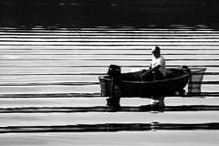Fisherman (Markus Moning) Tags: blackandwhite bw white lake black reflection net reflections boot grey see boat fisherman waves grau wave storage fisher sw schwarzweiss canoneos350d weiss welle schwarz lithuania fischer marios netz reflektion kaunas wellen moning stausee lietuva litauen kauno 123bw markusmoning