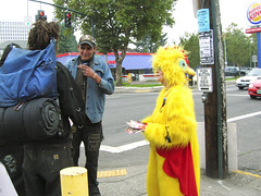 chicken lady (Zervas) Tags: street woman man guy chicken sign yellow dreadlocks lady oregon portland nose skull costume vegan homeless protest broadway literature smoking ring burgerking backpack peta kfc yellowchicken pdx nosering crosswalk syd colonel dreads kentuckyfriedchicken peacefulprotest holder jollyroger streetpeople protestsign sleepingbag pamphlets anticruelty costumed chickenlady chickencostume kfctortureschickens whitedreads veagan chickentorture sleeproll kfccrueltycom vegansyd kfccruelty