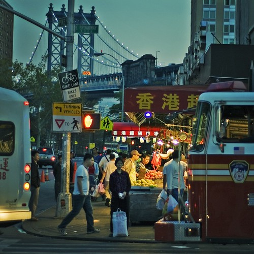 Night Market on East Broadway A lady with her bag of rice, waiting to cross. Chinatown, New York City
